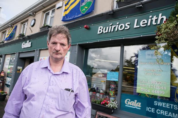 John Tully outside his shop in Twomileborris, Co Tipperary, which was robbed