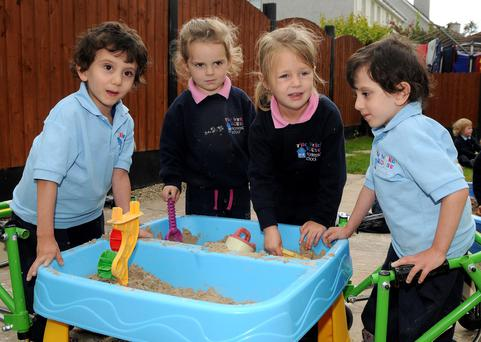 Looking forward to school: Benhaffaf twins Hassan and Hussein, playing with their friends, Emily Bernard and Caitlin Egan, at the Wendy House Montessori School in Carrigtwohill. Photo: David Keane