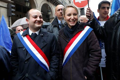 France's far-right Front National (FN) party MP Marion Marechal-Le Pen (R) and FN Senator and Mayor of Frejus David Rachline (L)