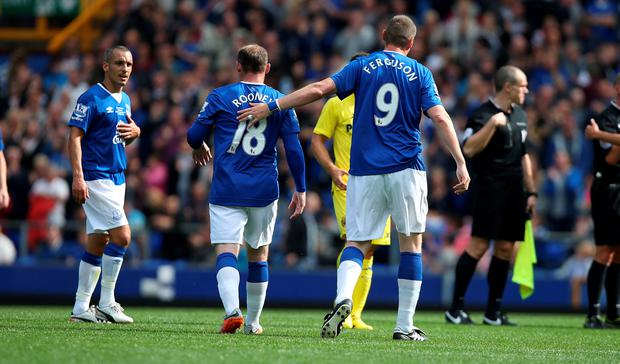 Leon Osman, Wayne Rooney and Duncan Ferguson during the pre-season friendly at Goodison Park