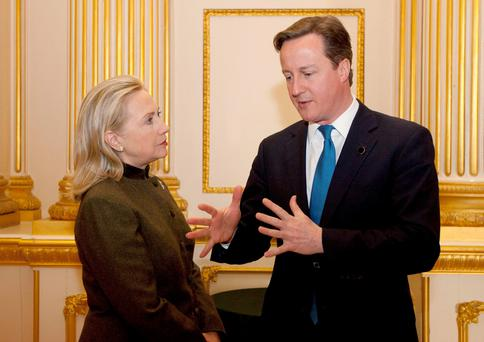 David Cameron talking to Hillary Clinton. A key confidant of the US presidential candidate told her Cameron was