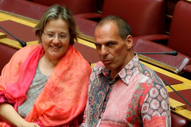 Greek Former Finance Minister Yanis Varoufakis and Vasiliki Katrivanou, a Syriza member of parliament, attend the Prime Minister's Questions at parliament in Athens, Greece July 31, 2015. REUTERS/Yiannis Kourtoglou