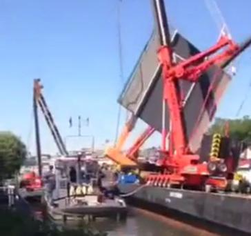 Some 20 people were reported injured when two cranes collapsed onto housing in a western Dutch town