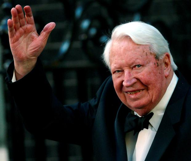 Former British Prime Minister Edward Heath waves as he arrives at number 10 Downing Street in London in this file photo dated April 29, 2002. Reuters/STR