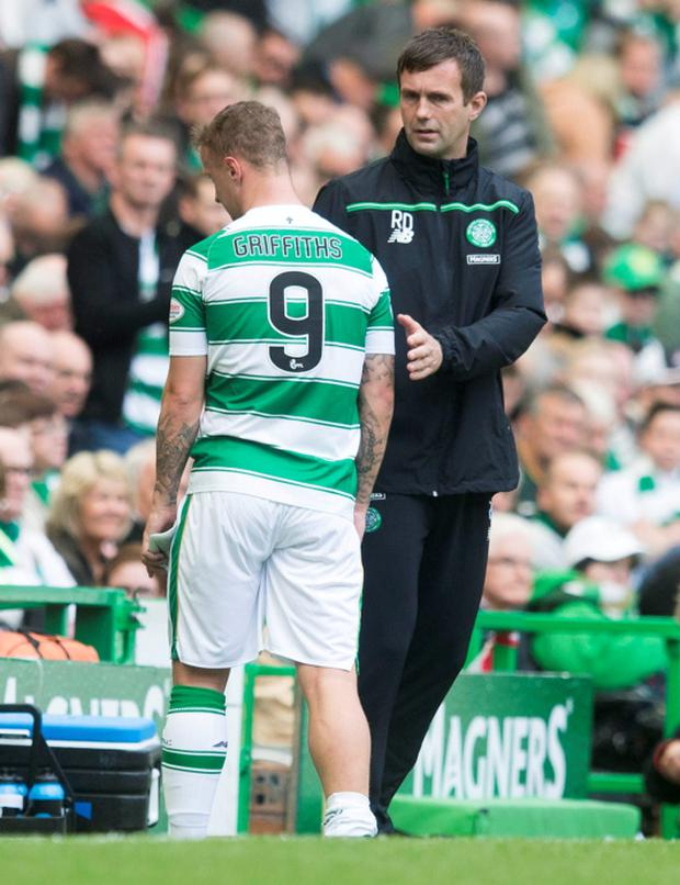 Celtic' Leigh Griffiths is ushered off with an injury by manager Ronny Deila during the Ladbrokes Premiership match against Ross County at Celtic Park, Glasgow.