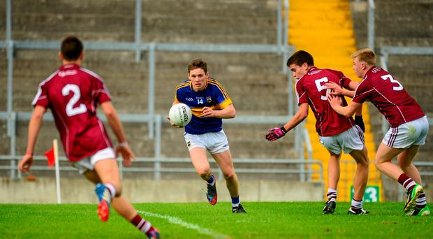 Tipperary's Alan Tynan takes on the Galway defence, from left, Caelom Mulry, Seán Kelly and Dylan McHugh
