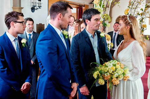 The music begins to play as Debbie Dingle [CHARLEY WEBB] and Cain Dingle [JEFF HORDLEY] walk down the aisle arm in arm. Debbie beams at Pete Barton [ANTHONY QUINLAN], relieved she seems to have managed to avoid disaster.