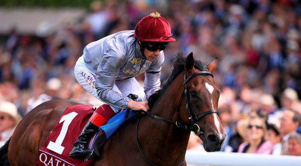 Shalaa ridden by Frankie Dettori on their way to victory in the Qatar Richmond Stakes during day three of the Glorious Goodwood Festival, Chichester
