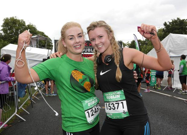 Siobhan Carew, left, and Lorna Maher, from Waterford celebrates after finishing the Rock n Roll half Marathon which finished in the Phoenix Park