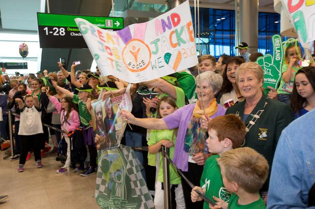Crowds await THe Team Ireland as they arrive home from The World Games At Dublin Airport today.
