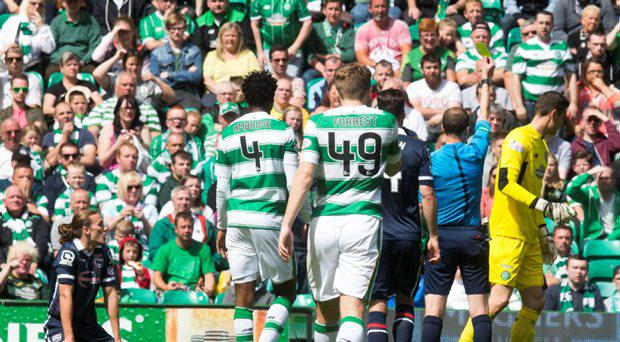 File photo dated 01-08-2015 of Celtic's Craig Gordon (right) is booked for penalty box challange on Ross County's Jackson Irvine (left) during the Ladbrokes Premiership match at Celtic Park, Glasgow