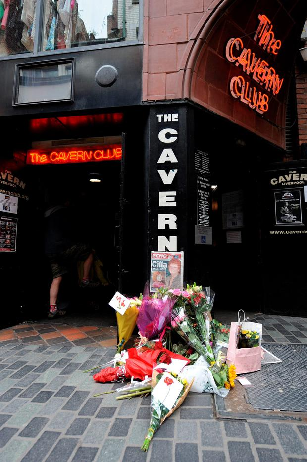 Cards and flowers outside the Cavern club in Liverpool following the death of Cilla Black at her home in Spain