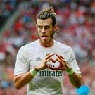 Gareth Bale celebrates after scoring the second goal for Real Madrid