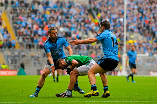 Dublin's Alan Brogan (left) puts pressure on Fermanagh's James McMahon in last Sunday's All-Ireland SFC quarter-final.