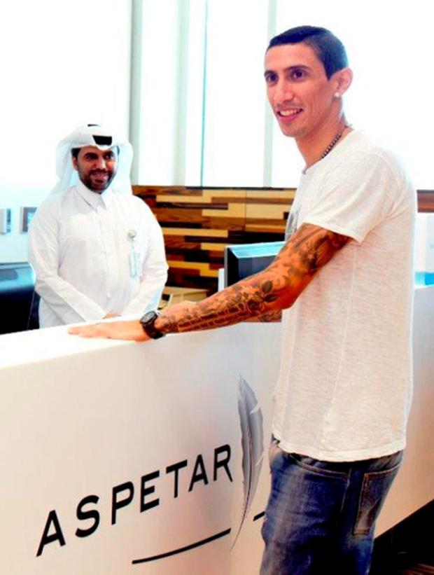 Angel Di Maria (R) arriving for a routine medical check at the Aspetar Orthopaedic and Sports Medicine Hospital in Doha ahead of his transfer from Manchester United to Paris Saint-Germain