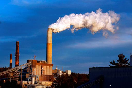 A plume of steam billows from the coal-fired Merrimack Station in Bow, New Hampshire, as President Barack Obama unveiled his unprecedented regulations clamping down on carbon dioxide emissions from existing US power plants. Photo: AP