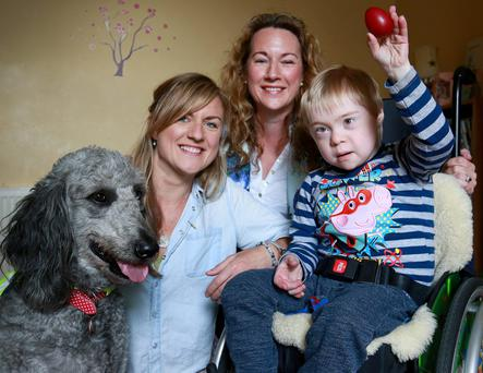 Jack McNiffe with his mum Aisling and aunt Trína, and Beth his dog. Photo: Frank McGrath