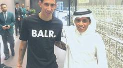 Angel Di Maria poses for a photo in Qatar - 'without permission' from United