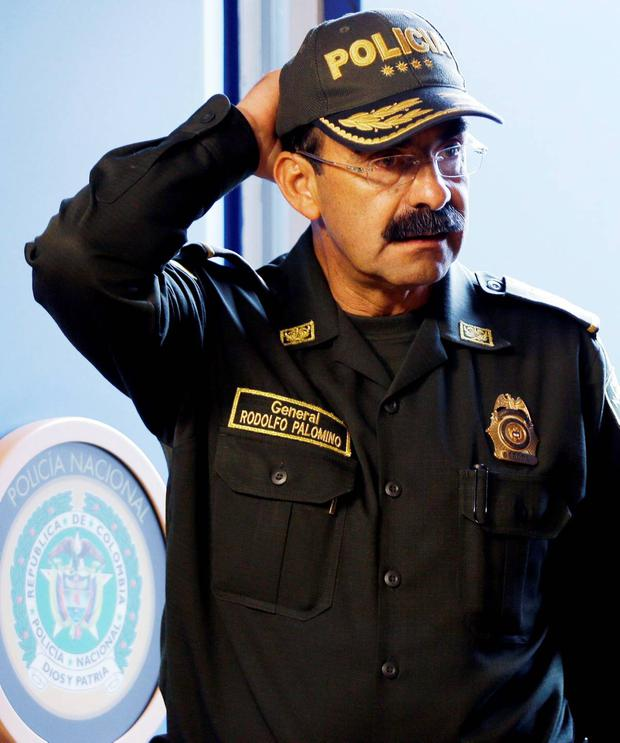 Colombia's Police Chief Gen. Rodolfo Palomino arrives to attends a press conference in Bogota, Colombia, Tuesday, Aug. 4, 2015. (AP Photo/Fernando Vergara)