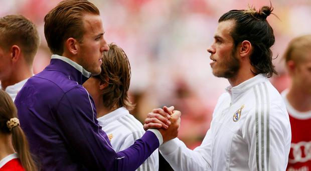 Real Madrid's Gareth Bale and Tottenham's Harry Kane shake hands before a friendly match last night