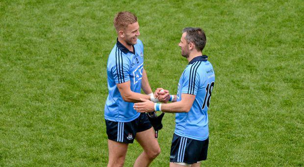 Johnny Cooper, left, and Alan Brogan, Dublin, celebrate after the Kildare game