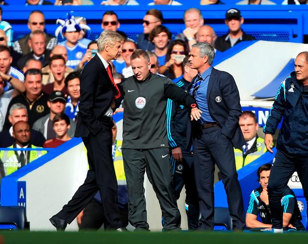Chelsea manager Jose Mourinho (right) has a heated exchange with Arsenal manager Arsene Wenger (left) on the touchline during the Barclays Premier League match at Stamford Bridge, London