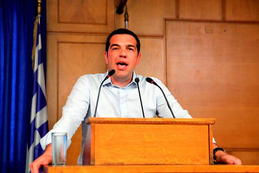 Greek Prime Minister Alexis Tsipras gives a speech at the Agriculture Ministry in central Athens, Greece, August 5, 2015. Tsipras said on Wednesday Greece is close to concluding a deal with lenders on a multi billion euro bailout, which he said would end doubts over the country's presence in the euro zone. REUTERS/Yiannis Kourtoglou