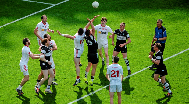Tyrone's Conor Clarke competes for a throw-in against Sligo's James Hynes