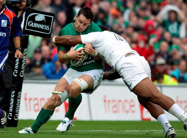 David Wallace is tackled by England's Manu Tuilagi, which resulted in the Munster man missing the 2011 World Cup