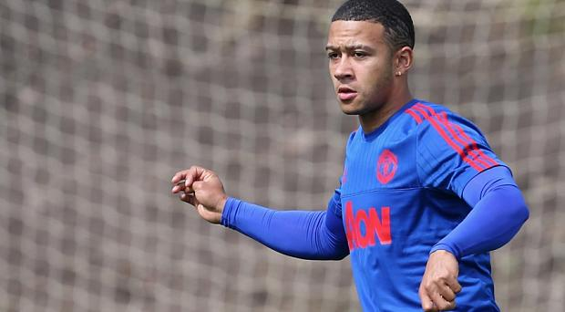 Memphis Depay of Manchester United in action during a first team training session