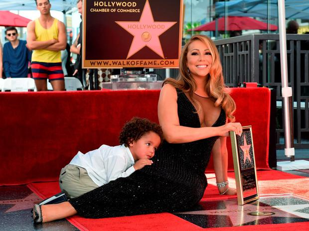 Singer Mariah Carey with son Moroccan Cannon is honored with the 2,556th star on The Hollywood Walk of Fame in Hollywood, California