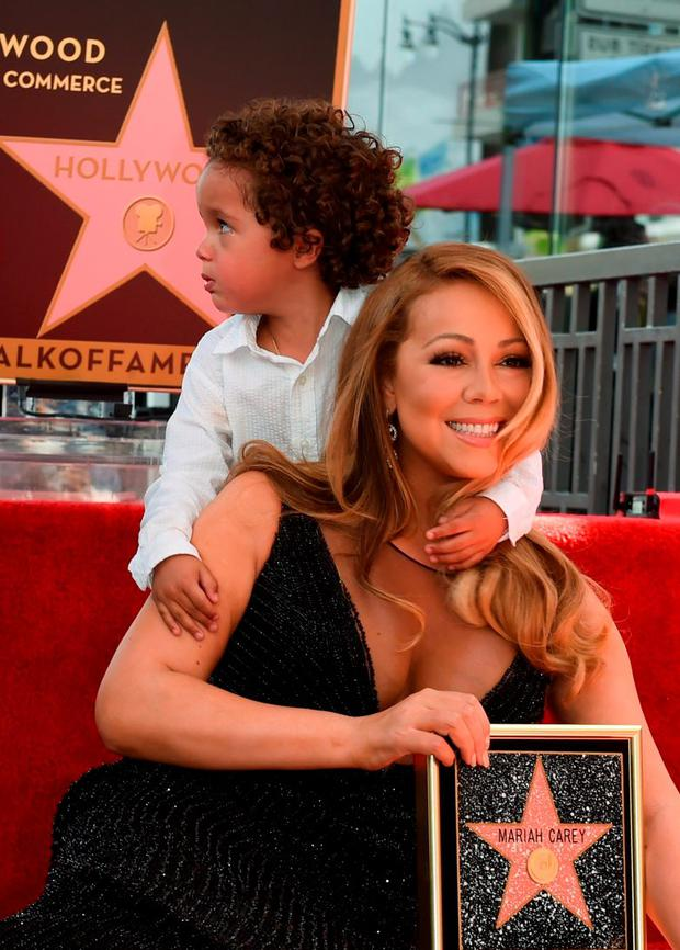 Singer Mariah Carey with son Moroccan Cannon is honored with the 2,556th star on The Hollywood Walk of Fame in Hollywood