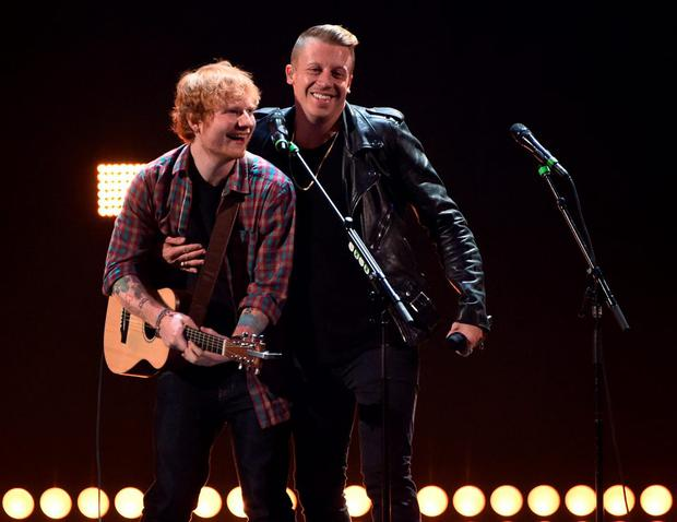 Singer/songwriter Ed Sheeran (L) and rapper Macklemore perform during the 2014 iHeartRadio Music Festival at the MGM Grand Garden Arena on September 20, 2014 in Las Vegas, Nevada.