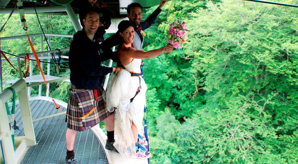 Ross Basham, 33, and Hannah Phillips, 27, who jump-started married life by holding their wedding on a bungee jump platform and then leapt 40 metres on the same cord at Garry Bridge near Killiecrankie in Perthshire. Photo: Highland Fling Bungee/PA Wire