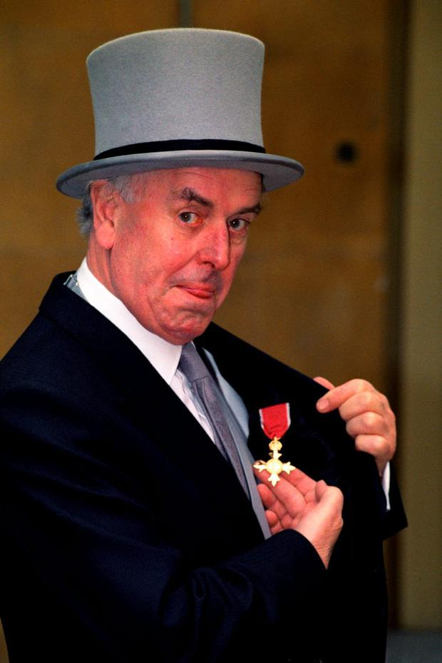 File photo dated 26/03/92 of actor George Cole at Buckingham Palace, London after receiving his OBE, as he has died aged 90