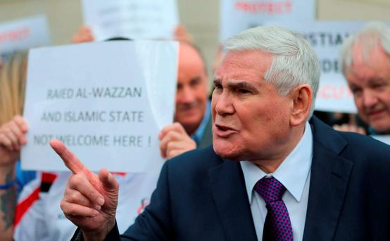 Evangelical preacher Pastor James McConnell speaking outside Belfast Magistrates' Court, he has been charged over a controversial sermon in which he branded Islam