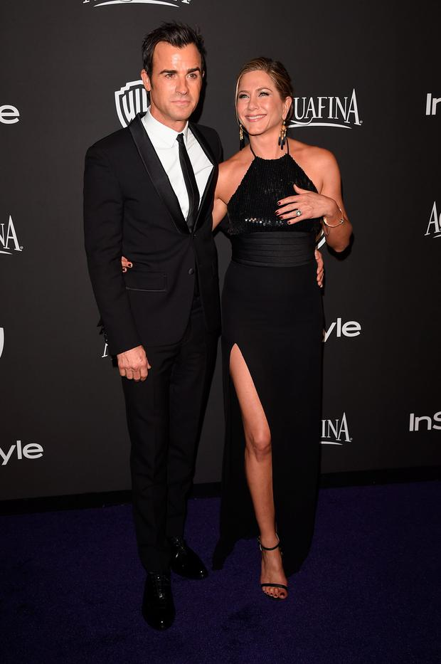 Actors Justin Theroux (left) and Jennifer Aniston attend the 2015 InStyle And Warner Bros. 72nd Annual Golden Globe Awards Post-Party at The Beverly Hilton Hotel on January 11, 2015 in Beverly Hills, California. (Photo by Jason Merritt/Getty Images)