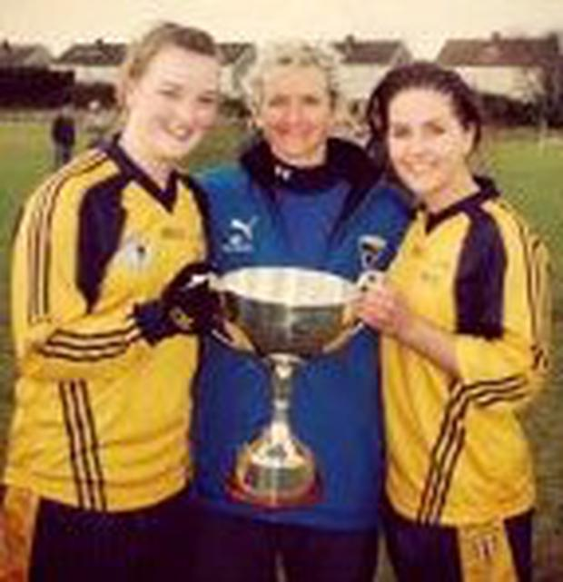 Ellen McCarron and Roisin O'Keeffe (right) with Angie McNally after helping DCU claim the O'Connor Cup – they will be on opposite sides tomorrow