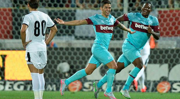 Manuel Lanzini of West Ham United, centre, celebrates scoring a goal during the Europa League, third qualifying round, second leg soccer match against Astra Giurgiu, in Giurgiu, Romania
