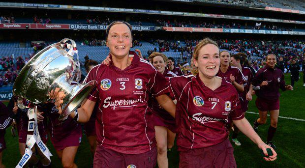 Sarah Dervan, left, and Lorraine Ryan, Galway, celebrate with the O'Duffy Cup after the game. Liberty Insurance All-Ireland Senior Camogie Championship Final, Galway v Kilkenny, Croke park, Dublin. Picture credit: Paul Mohan / SPORTSFILE