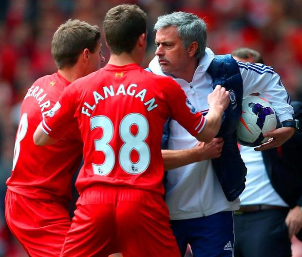Steven Gerrard and Jon Flanagan of Liverpool have words with Jose Mourinho