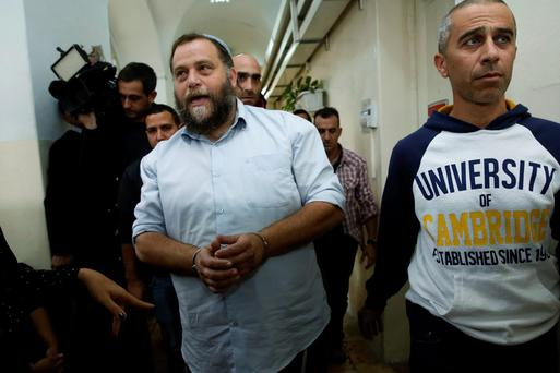 Israeli settler Benzi Gopstein, the leader of the extreme right-wing movement Lehava is pictured ahead of a court appearance in 2014. Photo: AFP/Getty Images