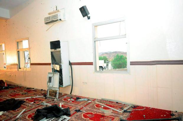 Damage inside a mosque used by members of a local security force is pictured in Abha, southwest Saudi Arabia.