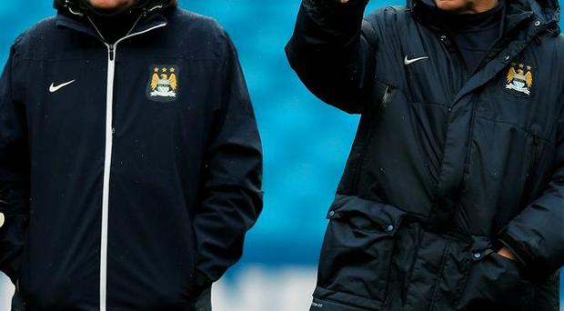 Veteran assistant boss Brian Kidd with Manuel Pellegrini at Manchester City