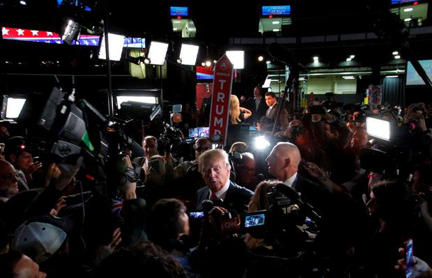 Republican 2016 U.S. presidential candidate businessman Donald Trump is surrounded by news media in the