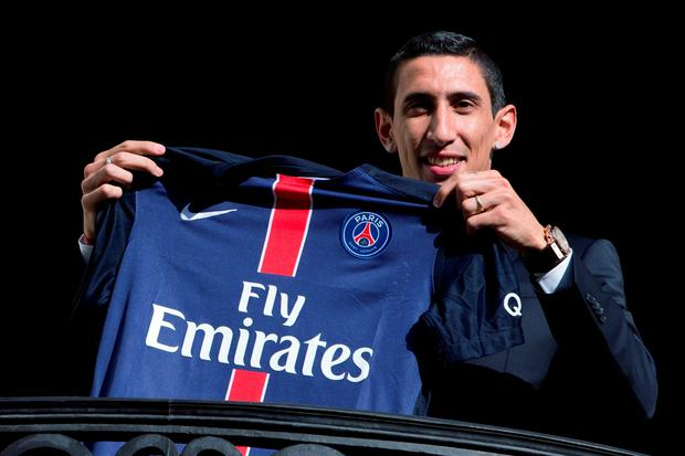 Paris Saint-Germain's (PSG) new Argentinian midfielder Angel Di Maria poses with his PSG jersey
