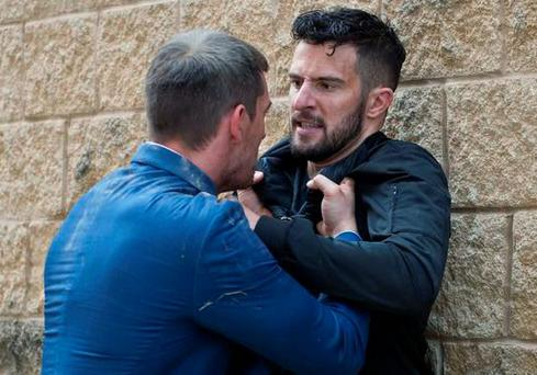 Pete and Ross fight outside the hospital in Emmerdale