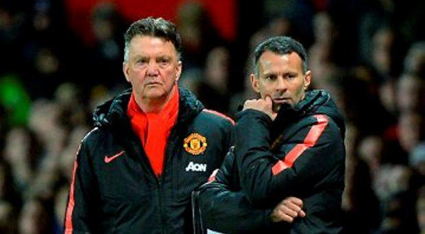 Manchester United assistant manager Ryan Giggs (right) and Manchester United manager Louis van Gaal (left)