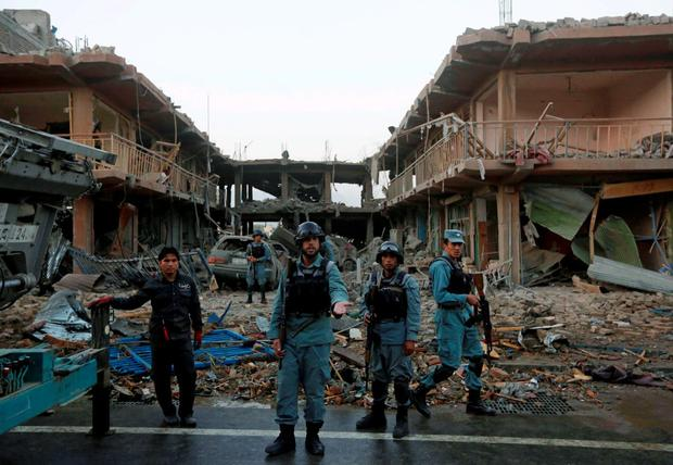 Afghan policemen stand guard at the site of a suicide truck bomb in Kabul. Reuters/Omar Sobhani