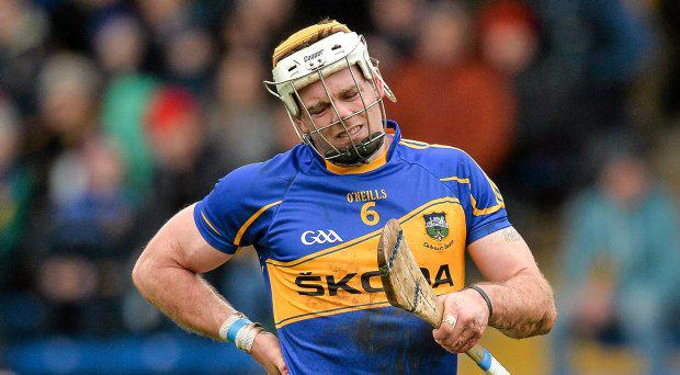 Padraic Maher, Tipperary, reacts after picking up an injury